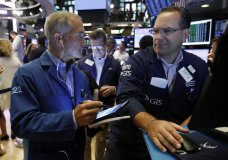 FILE - In this Friday, July 19 2019, file photo trader Timothy Nick, left, and specialist Anthony Matesic work on the floor of the New York Stock Exchange. The U.S. stock market opens at 9:30 a.m. EDT on Thursday, July 25. (AP Photo/Richard Drew, File)