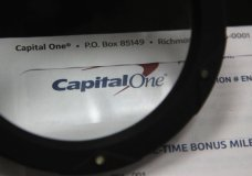 This July 22, 2019, photo shows Capital One mail in North Andover, Mass. A security breach at Capital One Financial, one of the nation's largest issuers of credit cards, compromised the personal information of about 106 million people, and in some cases the hacker obtained Social Security and bank account numbers. It is among the largest security breaches of a major U.S. financial institution on record. The bank's stock dipped 6% at the opening of trading Tuesday, July 30. (AP Photo/Elise Amendola)