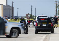 "CORRECTS THE NAME OF THE SOURCE TO THE MIDLAND REPORTER-TELEGRAM - Odessa and Midland police and sheriff's deputies surround the area behind Cinergy in Odessa, Texas, Saturday, Aug. 31, 2019, after reports of shootings. Police said there are ""multiple gunshot victims"" in West Texas after reports of gunfire on Saturday in the area of Midland and Odessa. (Tim Fischer/Midland Reporter-Telegram via AP)"