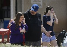 People arrive at MacArthur Elementary looking for family and friends as the school is being used a re-unification center during the aftermath of a shooting at the Walmart near the Cielo Vista Mall, Saturday, Aug. 3, in El Paso, Texas. Multiple people were killed and one person was in custody after a shooter went on a rampage at a shopping mall, police in the Texas border town of El Paso said. (Briana Sanchez/The El Paso Times via AP)