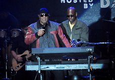 "Musician Stevie Wonder, front left, and comedian Dave Chappelle appear on stage during the ""Gem City Shine,"" event in the Oregon District in Dayton, Ohio, Sunday, Aug. 25, 2019. Chappelle, who resides in nearby Yellow Springs, hosted the special block party and benefit concert for those affected by the recent mass shooting. (Marshall Gorby/Dayton Daily News via AP)"