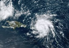 This GOES-16 satellite image taken Wednesday, Aug. 28, 209, at 17:20 UTC and provided by National Oceanic and Atmospheric Administration (NOAA), shows Dorian, a Category 1 hurricane, crossing over the U.S. and British Virgin Islands. Forecasters say it could grow to Category 3 status as it nears the U.S. mainland as early as the weekend. (NOAA via AP)
