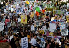 Climate protesters demonstrate in London, Friday, Sept. 20, 2019. Protesters around the world joined rallies on Friday as a day of worldwide demonstrations calling for action against climate change began ahead of a U.N. summit in New York. (AP Photo/Frank Augstein)