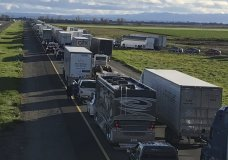 This Feb. 14, 2019, photo released by Caltrans District 3 shows a 7-mile back up on the South bound Interstate 5, as it reopens to traffic in Maxwell in Colusa County, Calif. The Trump administration is poised revoke California's authority to set auto mileage standards, asserting that only the federal government has the power to regulate greenhouse gas emissions and fuel economy. (Caltrans District 3 via AP)