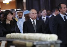 Russian President Vladimir Putin, center, stands before a service for late French President Jacques Chirac, at the Saint Sulpice, Monday, Sept. 30, 2019 in Paris. Past and current heads of states are gathering in Paris to pay tribute to former French President Jacques Chirac who died last week at the age of 86. (AP Photo/Francois Mori, Pool)