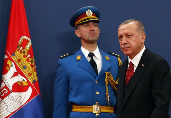 Turkey's President Recep Tayyip Erdogan, right, arrives at a joint news conference after talks with his Serbian counterpart Aleksandar Vucic, in Belgrade, Serbia, Monday, Oct. 7, 2019. Erdogan is on a two-day official visit to Serbia. (AP Photo/Darko Vojinovic)
