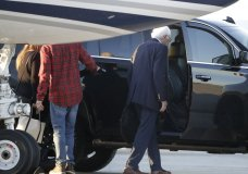 Democratic presidential candidate Sen. Bernie Sanders, I-Vt., right, enters a vehicle after disembarking from a plane at Burlington International Airport in South Burlington, Vt., on Saturday, Oct. 5, 2019. (AP Photo/Steven Senne)