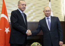 Russian President Vladimir Putin, right, and Turkish President Recep Tayyip Erdogan pose for a photo during their meeting in the Bocharov Ruchei residence in the Black Sea resort of Sochi, Russia, Tuesday, Oct. 22, 2019. Welcoming the Turkish leader in Russia's Black Sea resort of Sochi on Tuesday, Putin said their meeting is very important in the current tense situation in Syria. (AP Photo/Sergei Chirikov, Pool)