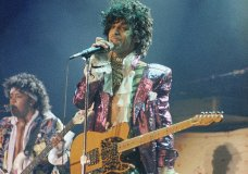 """FILE - In this 1985 file photo, singer Prince performs in concert. The Revolution, the band that helped catapult Prince to international superstardom is reuniting in his memory. """"Prince: The Beautiful Ones,"""" the memoir Prince started but didn't finish before his 2016 death, will be released on Tuesday, Oct. 29, 2019. (AP Photo/File)"""