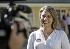 """FILE - In this Nov. 6, 2018 file photo, Katie Hill, then a Democratic Party candidate from California's 25th Congressional district, talks to a reporter after voting in her hometown of Agua Dulce, Calif. She won the election, flipping a traditional GOP stronghold. Now, U.S. Rep. Hill, D-Calif., has apologized to friends and supporters for engaging in an inappropriate affair with a campaign staffer, but she still let down Susan Slates, a fellow Democrat, who said she was """"disappointed,"""" but quickly jumped to Hill's defense, saying anything she did pales in comparison to what's she's witnessed under President Donald Trump. (AP Photo/Marcio Jose Sanchez, File)"""