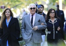 Roger Stone, center, with his wife, Nydia Stone, right, arrive at the federal court in Washington, Tuesday, Nov. 5, 2019. Stone, a longtime Republican provocateur and former confidant of President Donald Trump, goes on trial over charges related to his alleged efforts to exploit the Russian-hacked Hillary Clinton emails for political gain. (AP Photo/Manuel Balce Ceneta)