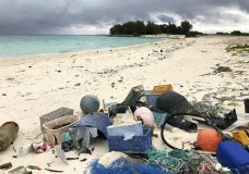 In this Oct. 22, 2019, photo, plastic and other marine debris sits on the beach on Midway Atoll in the Northwestern Hawaiian Islands. In one of the most remote places on Earth, Midway Atoll is a wildlife sanctuary that should be a safe haven for seabirds and other marine animals. Instead, creatures here struggle to survive as their bellies fill with plastic from faraway places. (AP Photo/Caleb Jones)