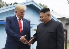 """FILE - In this June 30, 2019, file photo, North Korean leader Kim Jong Un, right, and U.S. President Donald Trump prepare to shake hands at the border village of Panmunjom in the Demilitarized Zone, South Korea. On Wednesday, Nov. 13, 2019, North Korea's supreme decision-making institution has lashed out at planned U.S.-South Korean drills and warned that the United States will face """"bigger threat and harsh suffering"""" if it ignores North Korean leader Kim Jong Un's end-of-year deadline to salvage the nuclear diplomacy. (AP Photo/Susan Walsh, File)"""