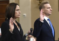 Former White House national security aide Fiona Hill, and David Holmes, a U.S. diplomat in Ukraine, are sworn in to testify before the House Intelligence Committee on Capitol Hill in Washington, Thursday, Nov. 21, 2019, during a public impeachment hearing of President Donald Trump's efforts to tie U.S. aid for Ukraine to investigations of his political opponents.(AP Photo/Susan Walsh)