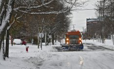 A snowplow removes about four inches of snow from a city street Wednesday, Nov. 27, 2019, in St. Cloud, Minn. According to the National Weather Service, St. Cloud received four inches of snow overnight. (Dave Schwarz/The St. Cloud Times via AP)