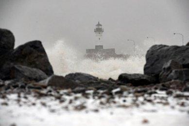 Large waves crash around the North Breakwater Lighthouse in Duluth, Minn., as snow falls on Wednesday, Nov. 27, 2019. (Alex Kormann/Star Tribune via AP)