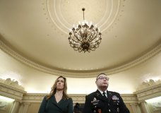 Jennifer Williams, an aide to Vice President Mike Pence, and National Security Council aide Lt. Col. Alexander Vindman stand as they take a break in hearing before the House Intelligence Committee on Capitol Hill in Washington, Tuesday, Nov. 19, 2019. (AP Photo/Andrew Harnik)
