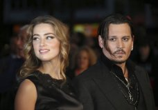 "FILE - In this Oct. 11, 2015 file photo, Amber Heard, left, and Johnny Depp arrive at the premiere of Depp's film ""Black Mass,"" at the London film festival. Free press advocates in Virginia are concerned that a libel lawsuit between Depp and Heard could set a bad precedent. The Virginia Press Association asked Friday, Nov. 8, 2019 to intervene in a $50 million lawsuit Depp filed against Heard, his ex-wife. Depp says he was defamed by an op-ed piece Heard wrote in The Washington Post in December 2018, in which she never identified Depp by name but referred to herself as a ""public figure representing domestic abuse."" Depp has denied abusing Heard and said the article clearly refers to earlier abuse allegations Heard made against him. (Photo by Joel Ryan/Invision/AP, File)"