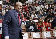 FILE - In this Aug. 15, 2019, file photo, former New York City Mayor Rudy Giuliani smiles as he arrives to President Donald Trump's campaign rally in Manchester, N.H. Federal prosecutors are planning to interview an executive with Ukraine's state-owned gas company as part of an ongoing probe into the business dealings of Giuliani and two of his Soviet-born business associates. (AP Photo/Elise Amendola, File)