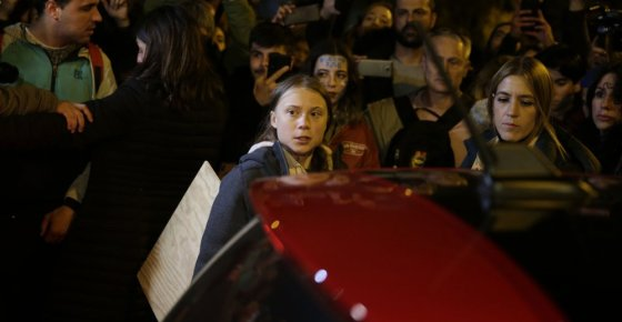 Climate activist Greta Thunberg, centre, leaves the protest in Madrid, Friday Dec. 6, 2019. Thunberg arrived in Madrid Friday to join thousands of other young people in a march to demand world leaders take real action against climate change. (AP Photo/Andrea Comas)