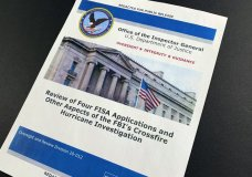 The cover page of the report issued by the Department of Justice inspector general is photographed in Washington, Monday, Dec. 9, 2019. The report on the origins of the Russia probe found no evidence of political bias, despite performance failures. (AP Photo/Jon Elswick)