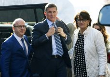 FILE - In this Dec. 1, 2017, file photo, Michael Flynn, center, arrives at federal court in Washington. A judge set a sentencing hearing for Michael Flynn after rejecting arguments from the former Trump administration national security adviser that prosecutors had withheld evidence favorable to his case. (AP Photo/Susan Walsh, File)