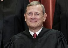 FILE - This Nov. 30, 2018, file photo shows Chief Justice of the United States, John G. Roberts, as he sits with fellow Supreme Court justices for a group portrait at the Supreme Court Building in Washington. Roberts will move from the camera-free, relative anonymity of the Supreme Court to the glare of television lights in the Senate to preside over President Donald Trump's impeachment trial. (AP Photo/J. Scott Applewhite, File)