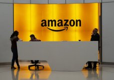 """FILE - In this Feb. 14, 2019, file photo people stand in the lobby for Amazon offices in New York. Amazon says President Donald Trump's """"improper pressure"""" and behind-the-scenes attacks harmed its chances of winning a $10 billion Pentagon contract. Amazon argues in a lawsuit unsealed Monday, Dec. 9, that the decision should be revisited because of """"substantial and pervasive errors"""" and Trump's interference. (AP Photo/Mark Lennihan, File)"""