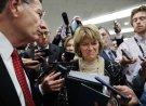 Sen. Lisa Murkowski, R-Alaska, center, and Sen. John Barrasso, R-Wyo., react to the final statement of House Democratic impeachment manager Rep. Adam Schiff, D-Calif., as they speak to the media at the end of a day of an impeachment trial of President Donald Trump on charges of abuse of power and obstruction of Congress, Friday, Jan. 24, 2020, on Capitol Hill in Washington. (AP Photo/Jacquelyn Martin)