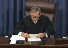 In this image from video, presiding officer Chief Justice of the United States John Roberts looks at a question submitted by Sen. Rand Paul, R-Ky., before declining to read the question as written during the impeachment trial against President Donald Trump in the Senate at the U.S. Capitol in Washington, Thursday, Jan. 30 2020. (Senate Television via AP)
