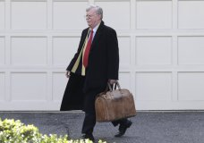 Former National security adviser John Bolton leaves his home in Bethesda, Md. Tuesday, Jan. 28, 2020. President Donald Trump's legal team is raising a broad-based attack on the impeachment case against him even as it mostly brushes past allegations in a new book that could undercut a key defense argument at the Senate trial. Former national security adviser John Bolton writes in a manuscript that Trump wanted to withhold military aid from Ukraine until it committed to helping with investigations into Democratic rival Joe Biden. (AP Photo/Luis M. Alvarez)