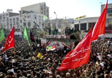 In this photo provided by The Iranian Students News Agency, ISNA, flag draped coffins of Gen. Qassem Soleimani and his comrades who were killed in Iraq in a U.S. drone strike, carried on a truck surrounded by mourners during their funeral in southwestern city of Ahvaz, Iran, Sunday, Jan. 5, 2020. The body of Soleimani arrived Sunday in Iran to throngs of mourners, as U.S. President Donald Trump threatened to bomb 52 sites in the Islamic Republic if Tehran retaliates by attacking Americans. (Alireza Mohammadi/ISNA via AP)