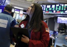 Trader Ashley Lara works on the floor of the New York Stock Exchange, Wednesday, Feb. 5, 2020. Stocks are opening broadly higher on Wall Street, putting the market on track for a third straight day of solid gains. (AP Photo/Richard Drew)