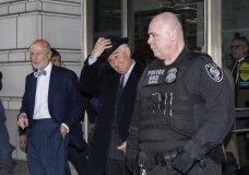 Roger Stone, center, puts his hat on as he departs after his sentencing at federal court in Washington, Thursday, Feb. 20, 2020. President Donald Trump loyalist and ally, Roger Stone was sentenced to over three years in federal prison, following an extraordinary move by Attorney General William Barr to back off his Justice Department's original sentencing recommendation. The sentence came amid President Donald Trump's unrelenting defense of his longtime confidant that led to a mini-revolt inside the Justice Department and allegations the president interfered in the case. (AP Photo/Alex Brandon)