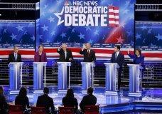 From left, Democratic presidential candidates, former New York City Mayor Mike Bloomberg, Sen. Elizabeth Warren, D-Mass., Sen. Bernie Sanders, I-Vt., former Vice President Joe Biden, former South Bend Mayor Pete Buttigieg, Sen. Amy Klobuchar, D-Minn., participate in a Democratic presidential primary debate Wednesday, Feb. 19, 2020, in Las Vegas, hosted by NBC News and MSNBC. (AP Photo/John Locher)