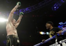 """Tyson Fury, left, of England approaches his trainer Javon """"SugarHill"""" Steward after defeating Deontay Wilder in a WBC heavyweight championship boxing match Saturday, Feb. 22, 2020, in Las Vegas. (AP Photo/Isaac Brekken)"""