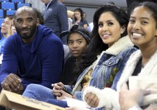FILE - In this Nov. 21, 2017 file photo, from left, Los Angeles Lakers legend Kobe Bryant, his daughter Gianna Maria-Onore Bryant, wife Vanessa and daughter Natalia Diamante Bryant are seen before a Connecticut-UCLA NCAA women's basketball game in Los Angeles. Kobe Bryant's widow on Monday, Feb. 24, 2020, sued the owner of the helicopter that crashed in fog and killed the former Los Angeles Lakers star and their 13-year-old daughter Gianna last month. The wrongful death lawsuit filed by Vanessa Bryant in Los Angeles Superior Court said the pilot was careless and negligent by flying in cloudy conditions Jan. 26 and should have aborted the flight. (AP Photo/Reed Saxon, File)