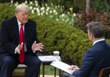 President Donald Trump talks with host Bill Hemmer during a Fox News virtual town hall with members of the coronavirus task force, in the Rose Garden at the White House, Tuesday, March 24, 2020, in Washington. (AP Photo/Evan Vucci)