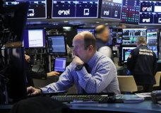 Trader Peter Mancuso prepares for the day's trading, on the floor of the New York Stock Exchange, Thursday, March 5, 2020. (AP Photo/Richard Drew)