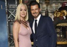 "FILE - This Aug. 21, 2019 file photo shows Orlando Bloom, right, a cast member in the Amazon Prime Video series ""Carnival Row,"" with singer Katy Perry, at the premiere of the series in Los Angeles. Perry has revealed she's pregnant at the end of the video for her latest song ""Never Worn White."" The news was confirmed Thursday by Perry's label, Capitol Music Group. The baby will be Perry's first, and the second for her fiance, Orlando Bloom, who has a 9-year-old son, Flynn, with ex-wife Miranda Kerr. (Photo by Chris Pizzello/Invision/AP, File)"