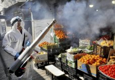 """A firefighter disinfects a traditional shopping center to help prevent the spread of the new coronavirus in northern Tehran, Iran, Friday, March, 6, 2020. A Health Ministry spokesman warned authorities could use unspecified """"force"""" to halt travel between major cities. (AP Photo/Ebrahim Noroozi)"""