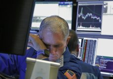 Specialist Timothy Nick works on the floor of the New York Stock Exchange, Monday, March 9, 2020. The Dow Jones Industrial Average plummeted 1,500 points, or 6%, following similar drops in Europe after a fight among major crude-producing countries jolted investors already on edge about the widening fallout from the outbreak of the new coronavirus. (AP Photo/Richard Drew)