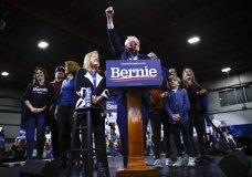 Democratic presidential candidate Sen. Bernie Sanders, I-Vt., accompanied by his wife Jane O'Meara Sanders and other family members, speaks during a primary night election rally in Essex Junction, Vt., Tuesday, March 3, 2020. (AP Photo/Matt Rourke)