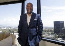 FILE - In this Sept. 5, 2019 file photo, comedian and media mogul Byron Allen poses for a picture Thursday, Sept. 5, 2019, in Los Angeles. The Supreme Court has thrown out a lower court ruling in favor of a black media mogul and comedian who's suing cable giant Comcast for racial discrimination. The justices agreed unanimously Monday that an appeals court applied the wrong legal standard in allowing business owner Byron Allen's $20 billion lawsuit against Comcast to go forward.(AP Photo/Chris Carlson)