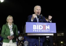 Democratic presidential candidate former Vice President Joe Biden, right, speaks next to his wife Jill during a primary election night rally Tuesday, March 3, 2020, in Los Angeles. (AP Photo/Marcio Jose Sanchez)