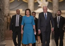 FILE - In this March 13, 2020, file photo Speaker of the House Nancy Pelosi, D-Calif., and Majority Leader Steny Hoyer, D-Md., arrive to make a statement ahead of a planned late-night vote on the coronavirus aid package deal, at the Capitol in Washington. Democrats are wrestling over how best to assail Trump for his handling of the coronavirus pandemic and the economy's shutdown even as the country enters an unpredictable campaign season against the backdrop of the most devastating crisis in decades. (AP Photo/J. Scott Applewhite, File)