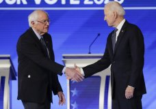 Democratic presidential candidates Sen. Bernie Sanders, I-Vt., left, and former Vice President Joe Biden, shake hands on stage Friday, Feb. 7, 2020, before the start of a Democratic presidential primary debate hosted by ABC News, Apple News, and WMUR-TV at Saint Anselm College in Manchester, N.H. (AP Photo/Charles Krupa)