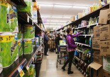 FILE - In this March 12, 2020, file photo, customers shop for cleaning products as market employees restock shelves in Aspen, Colo. Reports of accidental poisonings from cleaners and disinfectants are up sharply, and researchers believe it's related to the coronavirus epidemic. Such poisonings were up about 20 percent in the first three months of this year, compared to the same periods in 2018 and 2019.. The Centers for Disease Control and Prevention released the report Monday, April 20. (Kelsey Brunner/The Aspen Times via AP, File)