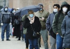 People line up at Gotham Health East New York, a COVID-19 testing center Thursday, April 23, 2020, in the Brooklyn borough of New York. (AP Photo/Frank Franklin II)