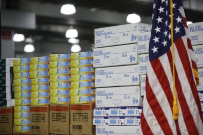 FILE - In this March 24, 2020, file photo stacks of medical supplies are housed at the Jacob Javits Center that will become a temporary hospital in response to the COVID-19 outbreak in New York. A review of federal purchasing contracts by The Associated Press shows federal agencies waited until mid-March to begin placing bulk orders of N95 respirator masks, mechanical ventilators and other equipment needed by front-line health care workers. (AP Photo/John Minchillo, File)